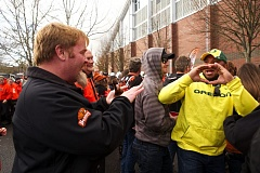 Oregon State fan Joe Zaback (left) of Corvallis and Oregon fan Gabe Johnson of Portland compare hand signs outside Reser Stadium.