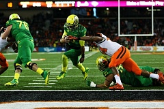 Photo Credit: COURTESY OF DAVID BLAIR - Oregon quarterback Marcus Mariota squirts into the end zone against Oregon State.