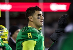 Photo Credit: TRIBUNE PHOTO: JAIME VALDEZ - Marcus Mariota's haul at Corvallis on Saturday included a 47-19 Oregon Ducks victory over Oregon State, four touchdown passes and two TD runs.