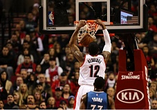 Photo Credit: COURTESY OF DAVID BLAIR - LaMarcus Aldridge dunks for the Trail Blazers as Minnesota's Thaddeus Young watches Sunday night at Moda Center.