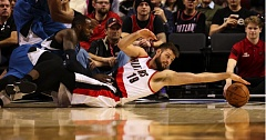 Joel Freeland of the Blazers stretches for a loose ball against Minnesota.