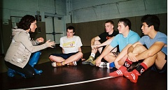 Photo Credit: JOHN DENNY - Olympian Kelsey Campbell (left) visits with Milwaukie High School seniors (left to right) Cody Neuhaus, Kenan Ragan, Clay Bispham and Chris Burton during last Thursdays wrestling practice.