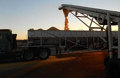 Photo Credit: CONTRIBUTED PHOTO - Dried distilled grain is loaded onto a truck for shipment to local feedlot owners. The City of Prineville Railway has seen a business boost from shipping the product by rail.
