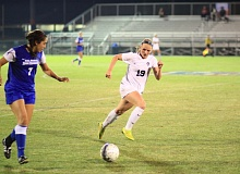 Photo Credit: COURTESY OF CONCORDIA UNIVERSITY - Concordia forward Erin Huisingh (right) chases down the ball and Cal State San Marcos' Natalie Lara during a second-game game at the NAIA tournament in Orange Beach, Ala. Concordia won 1-0 Monday night.