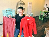 Photo Credit: GARY ALLEN - Open soon - Tiffany Darwich displays some of the clothing that will be for sale at DarLin Vintage on First Street. The shop is expected to open Thursday.