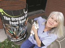 Photo Credit: REVIEW FILE PHOTO: VERN UYETAKE - Dana Lionel's Oregon Cat Project on B Avenue included a no-kill shelter, thrift store and cat food bank.
