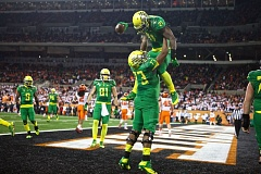 Photo Credit: COURTESY OF DAVID BLAIR - Oregon running back Royce Freeman gets a lift from offensive lineman Tyrell Crosby after scoring against Oregon State last week in Corvallis.
