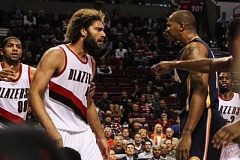 Robin Lopez and David West have words during Thursday night's Portland-Indiana NBA game at Moda Center.