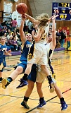 Photo Credit: LON AUSTIN/CENTRAL OREGONIAN - Crook County's Kimmer Severance is fouled by Abby Nonnenmacher of Burns while Catherine Clemens doubleteam's Severance. Severance finished the game with 19 points to lead Crook County which lost 68-41 to the Highlanders.