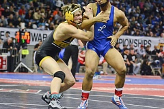 Photo Credit: JOHN WILLIAM HOWARD - Myles Terry battles KiAnte Davis of Lebanon in the second round of the 5A 152 lb. bracket at the state championships last season. Terry will likely stay up at 182 lbs, hoping to exploit a thinner field of athletes.