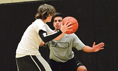 Photo Credit: JOHN WILLIAM HOWARD - St. Helens senior Ivan Alcazar makes a defensive stop during tryouts in mid-November.
