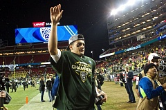 Marcus Mariota, MVP of the Pac-12 championship game, waves to the crowd after the Oregon Ducks' 51-13 victory over the Arizona Wildcats at Levi's Stadium in Santa Clara, Calif.
