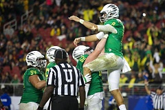 Photo Credit: TRIBUNE PHOTO: JAIME VALDEZ - Oregon offensive linemen greet Marcus Mariota after a Ducks touchdown, and Matt Pierson (second from right) gives him a boost. The No. 2-ranked Ducks beat Arizona 51-13 at Levi's Stadium in Santa Clara, Calif.