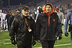Photo Credit: TRIBUNE FILE PHOTO - Oregon State athletic director Bob De Carolis (left) is expected to move quickly in hiring a football coach to replace Mike Riley (right), who has taken over as coach at Nebraska.