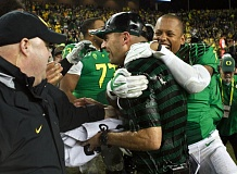 Oregon coach Mark Helfrich is drenched in the final moments of the game.