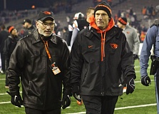 Photo Credit: TRIBUNE FILE PHOTO - Bob De Carolis (left), Oregon State athletic director, is looking for the replacement to Mike Riley (right), who moved on from the Beavers and is the new football coach at Nebraska.