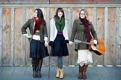 Photo Credit: SUBMITTED PHOTO - Wilsonville artists (From right) Michele Van Kleef, Naomi LaViolette and Christina Cooper have teamed up for the past five years to bring holiday music to Wilsonville stages.