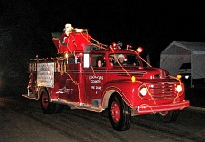 Photo Credit: PHOTO COURTESY: CLACKAMAS FIRE - Santa appears in a neighborhood parade hosted by Clackamas Fire District No. 1 personnel.