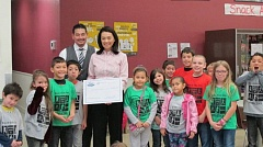 Photo Credit: COURTESY BOYS & GIRLS CLUB - Scott Inukai and Shannon Inukai-Cuffee from Dick's Auto Group presented a $2,000 check Tuesday to Hillsboro's Boys & Girls Club.
