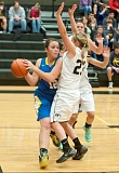 Photo Credit: LON AUSTIN/CENTRAL OREGONIAN - Kimmer Severance goes to the basket against a double-team from Sisters during their game on Friday. Sisters won the game 46-43 despite 30 points from Severance.