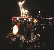 Photo Credit: LINDSAY KEEFER - In addition to decking out her golf cart, one Estates resident also towed a lit-up Christmas tree in the parade last week.