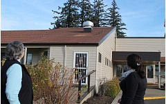 Photo Credit: PEGGY SAVAGE - Volunteer Lola Marie Nofzinger and center Director Cecily Rose check out the roof damage last week at the Molalla Adult Community Center. The center's Annual Appeal total as of November 15 was $25,000. The goal is $38,000, which would be enough to pay for a new roof.