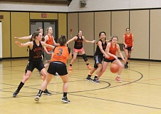 Photo Credit: JEFF WILSON/THE PIONEER - With all five starters returning, including Emma Hoke, with the ball, being guarded by Andrea Retano, the Dogs have playoff aspirations this season.