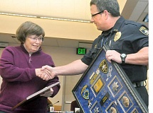 Photo Credit: GARY ALLEN - Honored - Police Chief Brian Casey presented Harding with a shadow box at a recent City Council meeting where she was recognized for her service.