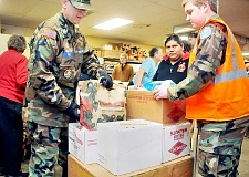 Photo Credit: GARY ALLEN - Helping hand - The Civil Air Patrol assists during the annual F.I.S.H. Christmas box distribution event in 2013. While the winter months have traditionally been a busier time for the food pantry, in recent years it is experiencing little downtime throughout the year.