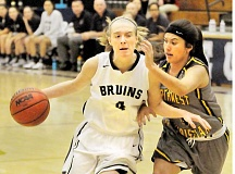 Photo Credit: SETH GORDON - Make way - Nicole Blizzard works her way past a defender during George Fox's 92-52 home victory over Northwest Christian Dec. 2.