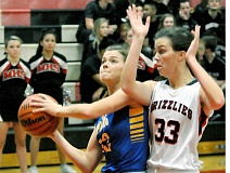 Photo Credit: SETH GORDON - Attack position - Natalie Peterson makes a move to the hoop during Newberg's  season-opening 54-31 win at rival McMinnville. Peterson scored six points in her first varsity start.