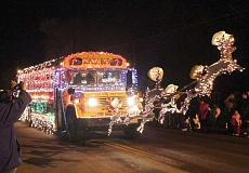 Photo Credit: HOLLY M. GILL - School District 509-J's bus barn won first place in Best of Lights in the Madras-Jefferson County Chamber of Commerce's Christmas Lights Parade on Saturday.