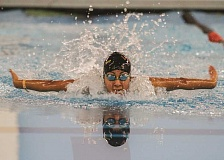 Photo Credit: NEWS-TIMES PHOTO: CHASE ALLGOOD - Forest Grove senior Alondra Martinez swims to victory in the girls 100-yard butterfly last Thursday in the Vikings' season-opening meet.