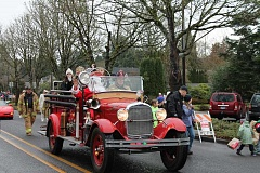 Photo Credit: TIDINGS PHOTO: PATRICK MALEE - Santa and West Linn's Old Time Fair Princesses arrived on an antique fire engine to kick off the West Linn Holiday Parade Dec. 6.
