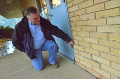 Photo Credit: REVIEW PHOTO: VERN UYETAKE - LOSD Facility Operations Director Rob Dreier points to a problem area at Lakeridge Junior High Schools West Campus.