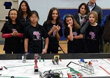 Photo Credit: REVIEW PHOTO: JILLIAN DALEY - Members of Get with the Program, an all-girls robotics team, nervously watch their robot move through an obstacle course during a practice tournament last Friday (from left): Roselyn Dai, Lexi Burck, Anita Oprea, Tessa DiVergilio and Bailey Tharp (between Tessa and Bailey is Anitas mom, Irina Oprea).