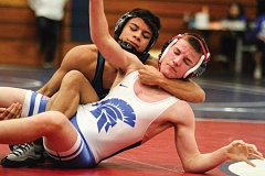 Photo Credit: HILLSBORO TRIBUNE PHOTO: AMANDA MILES - Century's Brennan Baccay wrestles Hilhi's Matt Peterson last Friday in a 138-pound match at the Ron James Round Robin tournament.
