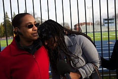Photo Credit: TRIBUNE PHOTO JAIME VALDEZ - Dalessa Miller consoles her daughter, Queeni, 17, while being interviewed by the media. Queeni saw her cousin, David, bleeding from the stomach after being shot during the lunch hour at Rosemary Anderson High School.