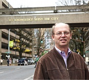 Photo Credit: TRIBUNE PHOTO JAIME VALDEZ - Portland State University associate professor Gerard Mildner teaches real estate courses at the School of Business Administration.