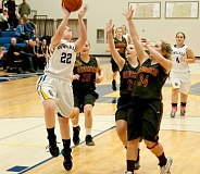 Photo Credit: LON AUSTIN/CENTRAL OREGONIAN - Michaeline Malott goes up for a layup during the Cowgirls loss to the Redmond Panthers Friday night. Malott led the CCHS in scoring with 12 points.