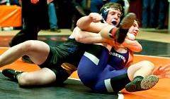 Photo Credit: LON AUSTIN/CENTRAL OREGONIAN -  Carson Raymond puts Ridgeview's Brent Yeakey in a cradle during the Culver Invitational. Raymond finished second in the 195-pound weight class at the tourament as the Cowboys' JV squad took third in the varsity tournament.