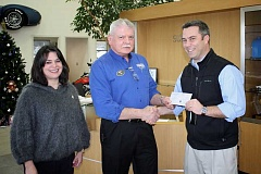 Photo Credit: POST PHOTO: KYLIE WRAY - Erinn Sowle and D.J. Anderson, of Suburban Ford, present SHS Athletic Director Wade Lockett with a check for $4,200.