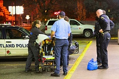 Photo Credit: DAVID F. ASHTON - Paramedics tend to a person needing immediate medical attention after reportedly ingesting a synthetic drug - bath salts.