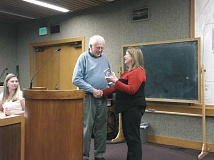 Photo Credit: PHOTO COURTESY THE CITY OF WOODBURN - Mayor Kathy Figley shakes hands with outgoing city Councilor Jim Cox during a brief ceremony at the Dec. 8 meeting.