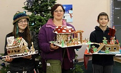 Photo Credit: NEWS-TIMES STAFF PHOTOS - Iris, Candy and Ian Cebula of Forest Grove all won prizes in this years Gingerbread House Contest as part of the Holiday in the Grove festivities with their traditional, mushroom and pirate-ship designs.