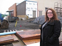Photo Credit: GAZETTE PHOTO: RAY PITZ - Maggie Chapin, the new manager of Sherwood's new cultural arts/community center, stands outside the center in early December. The 15,000-square-foot facility will open in February.