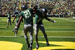 Photo Credit: COURTESY OF DAVID BLAIR - Keanon Lowe (right) celebrates with running back Royce Freeman after an Oregon Ducks touchdown. Lowe, a senior from Jesuit High, has been a leader on and off the field at UO, when healthy or injured.