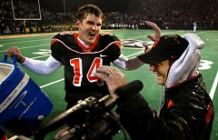 Photo Credit: TRIBUNE FILE PHOTO: JIM CLARK - During happy times at Oregon State, quarterback Derek Anderson celebrates a victory by dumping ice water on coach Mike Riley.