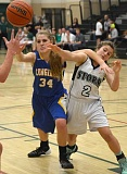 Photo Credit: PHOTO COURTESY OF FRED HOUSTON JR - Crook County's Ashton Morgan and Summit's Tiana Loftus fight for a ball during the Cowgirls loss to the Storm Tuesday night. Summit rolled past the Cowgirls 59-16 in the contest to run their record to 5-0, while the Cowgirls fell to 0-4 on the year.