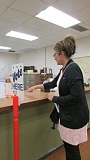 Photo Credit: COURTNEY VAUGHN - Bronwyn Talebi drops off her ballot at the Columbia County Courthouse on Nov. 4. A close count in the votes for Measure 92 led to a recount, although voters in Columbia County clearly rejected the measure.